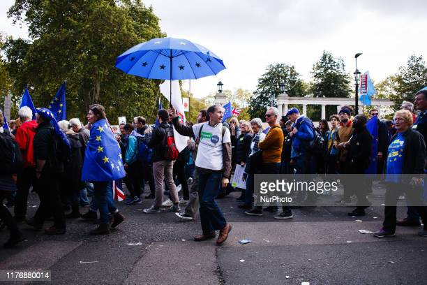 A demonstrator carries an umbrella designed with the EU flag along Piccadilly during the mass 'Together for the Final Say' march organised by the...