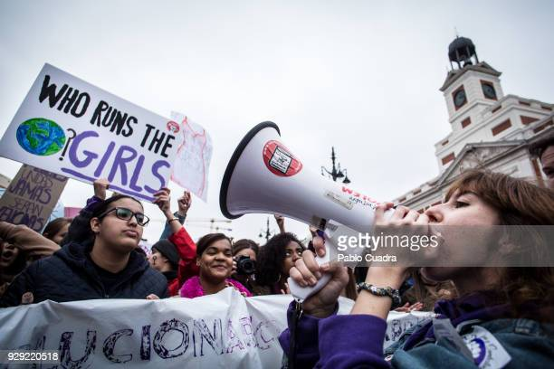 Demonstrator chants over a megaphone during a one day strike to defend women's rights on International Women's Day in Madrid, on March 8, 2018. Spain...