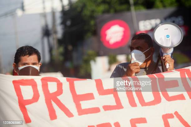 A demonstrator chants slogans with a megaphone asking for the payment of veteran pensions during a veterans protest from the former guerrilla Frente...