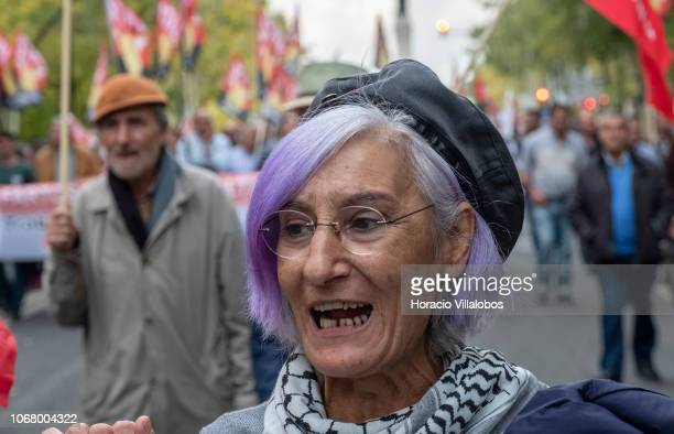 Demonstrator chants while parading along Avenida da Liberdade during a demonstration hosted by the CGTP to advocate for better workers' rights and...