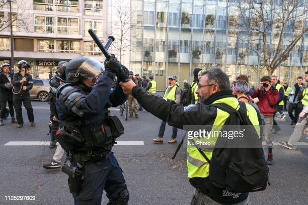Demonstrator clashes with a Police officer during a Yellow vest antigovernment demonstration on February 16 2019 in Paris Demonstrators hit French...