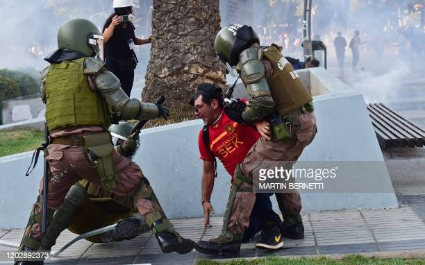 Demonstrator clashes with the police during a protest against Chilean President Sebastian Pinera's government in Vina del Mar, on February 23 during...