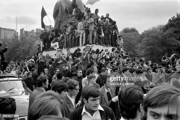 Demonstrator climb on the statue of the Lion of Belfort place Denfert Rochereau during the demonstration of May 13 1968 in Paris Students march 13...