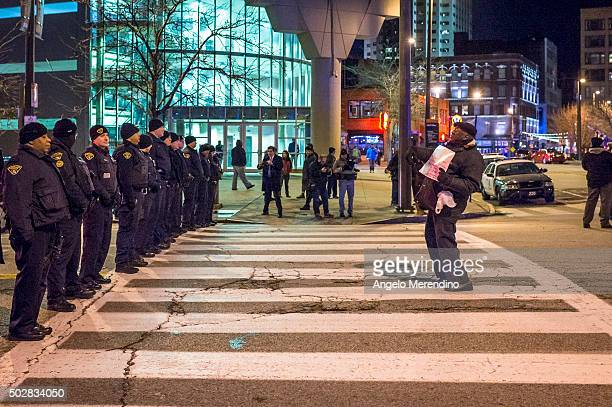 A demonstrator confronts police in front of Quicken Loans Arena on Huron Road on December 29 2015 in Cleveland Ohio Protestors took to the street the...