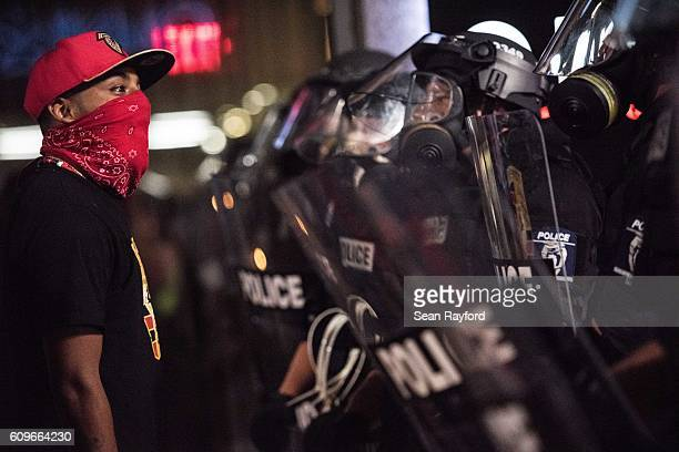 Demonstrator confronts police officers in riot gear September 22 2016 in downtown Charlotte NC Protests in Charlotte began on Tuesday in response to...
