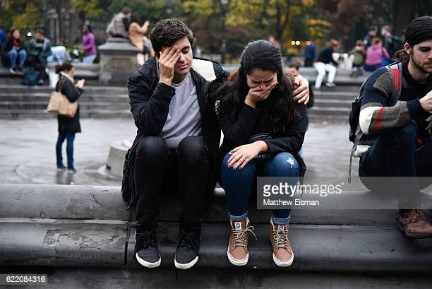 Demonstrator cries and is consoled by another demonstrator while protesting against Donald Trump's presidency at Washington Square Park on November...