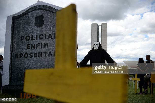 A demonstrator disguised as death protest against a bill that proposes the pension system law reform for 31 working categories linked to public...