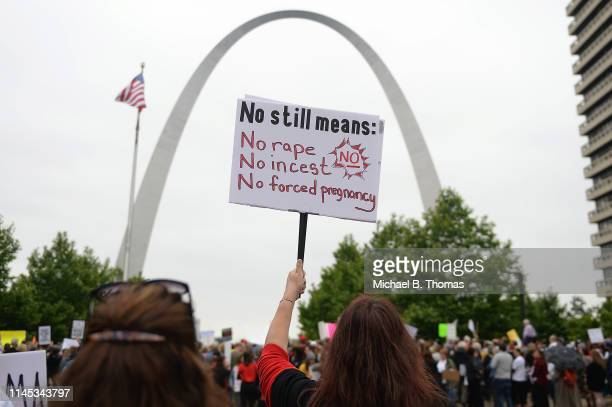 A demonstrator displays a sign during a protest rally over recent restrictive abortion laws on May 21 2019 in St Louis Missouri Rallies were planned...