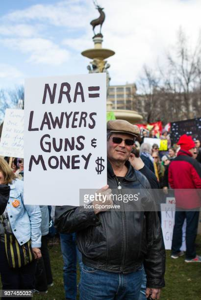 A demonstrator displays his sign during the March For Our Lives Rally on March 24 at the Connecticut State Capitol in Hartford CT