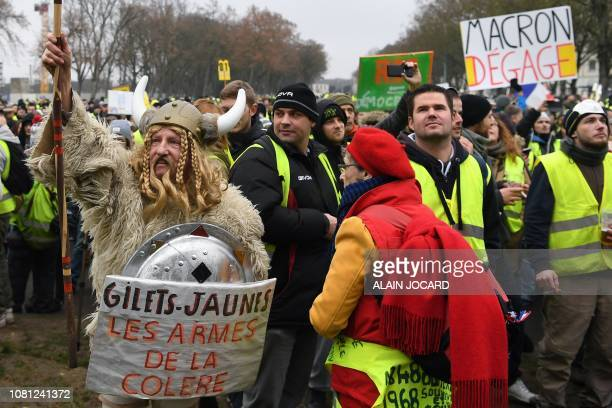 A demonstrator dressed as a Gaul holding a spear and a shield with a message reading Yellow Vests Weapons of Wrath during an antigovernment...