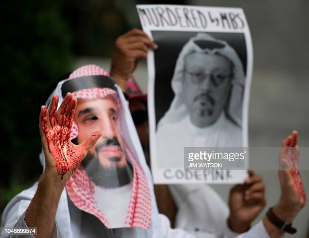 A demonstrator dressed as Saudi Arabian Crown Prince Mohammed bin Salman with blood on his hands protests outside the Saudi Embassy in Washington DC...