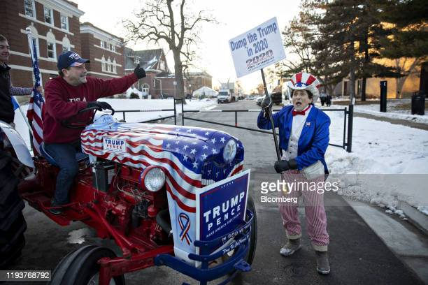 A demonstrator dressed as Uncle Sam right recites a poem denouncing US President Donald Trump as a supporter of President Trump looks on from the...