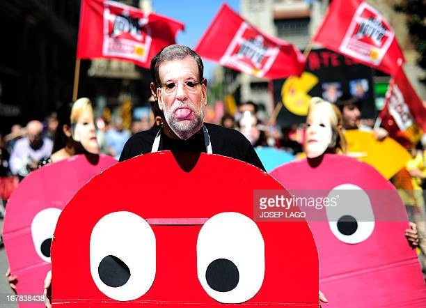 A demonstrator dressed up as a character of the video game PacMan and wearing a mask of Spanish Prime Minister Mariano Rajoy takes part a Labour Day...