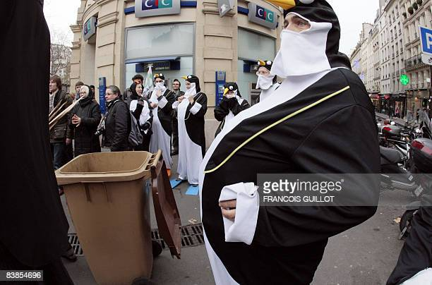 Demonstrator dressed up as a penguin attends a protest to denunce climate change, on November 29 in Paris. A United Nations Framework convention on...