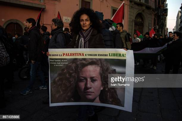 A demonstrator exposes a banner during the demonstration in favor of Jerusalem the capital of Palestine asking for freedom for the young Ahed Tamimi...