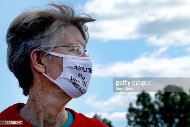Demonstrator expresses opposition to the death penalty during a protest near the Federal Correctional Complex where Daniel Lewis Lee is scheduled to...
