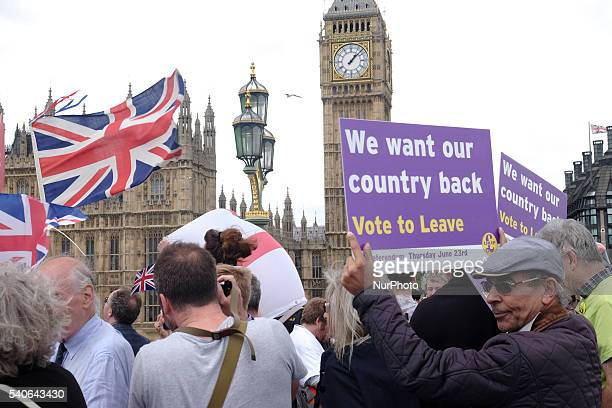 A demonstrator for the 'Leave' campaign holds a placard outside Houses of Parliament in London UK on Wednesday June 15 2016 The Brexit battle took to...