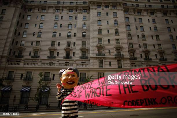 A demonstrator from the organization Code Pink for Peace wears a mask of former Secretary of State Condoleezza Rice outside the National Press Club...