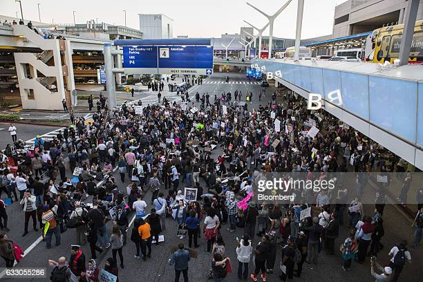 Demonstrator gathers outside Los Angeles International Airport to protest against U.S. President Donald Trump's executive order blocking visitors...
