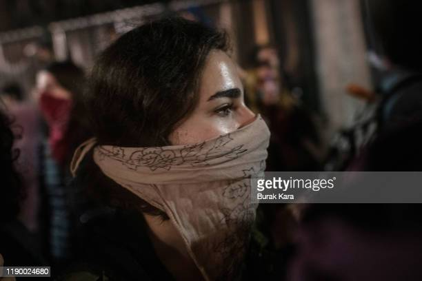 A demonstrator gathers to protest against femicide and violence against women on November 25 2019 in Istanbul Turkey November 25 is international day...
