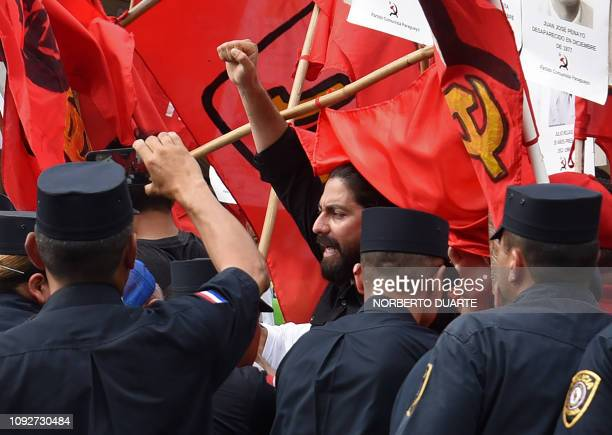 A demonstrator gestures as they struggle with the police during the commemoration of the 30th anniversary of the end of the dictatorship of General...