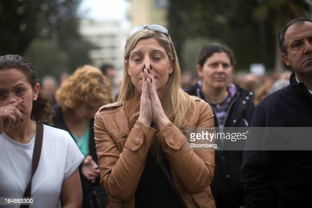 A demonstrator gestures during a protest by bank workers outside the Cypriot central bank in Nicosia Cyprus on Tuesday March 26 2013 Controls on...
