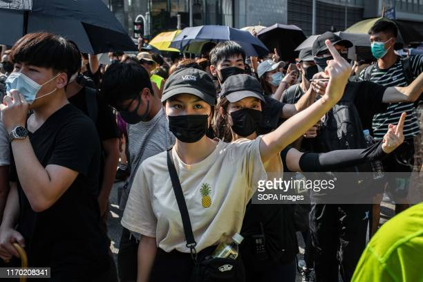 Demonstrator gestures during the protests Protesters continue to demonstrate across Hong Kong for the 15th consecutive week Demonstration were held...