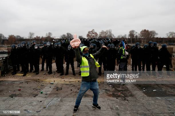 TOPSHOT A demonstrator gestures in front of riot police officers on January 5 2019 in Paris during an antigovernment demonstration called by the...