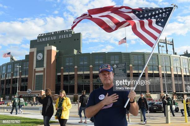 A demonstrator greets fans outside of Lambeau Field prior to a game between the Green Bay Packers and the Chicago Bears on September 28 2017 in Green...