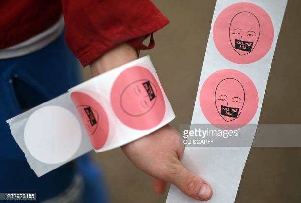Demonstrator hands out stickers as they take part in a protest against the Police, Crime, Sentencing and Courts Bill 2021 in Sheffield, norther...