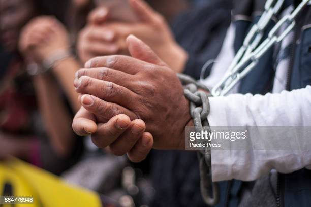 SYNTAGMA ATHENS ATTIKI GREECE A demonstrator has chained his hands in protest against the sale of slaves Greek activists demonstrate in Athens in...