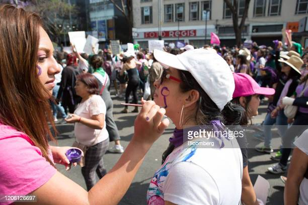 A demonstrator has her face painted during a rally on International Women's Day in Mexico City Mexico on Friday March 8 2020 The United Nations first...