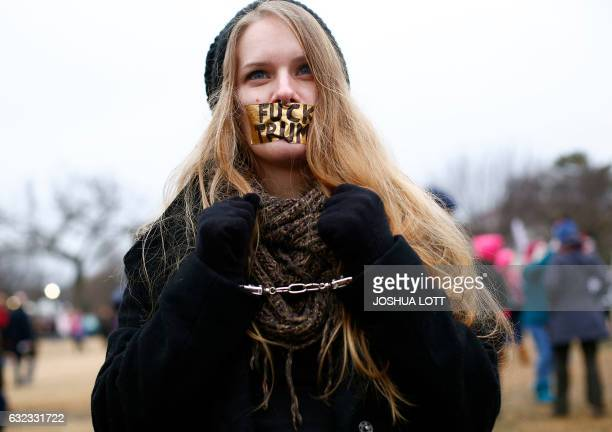 TOPSHOT A demonstrator has her mouth covered with tape and is handcuffed during the Women's March on January 21 2017 in Washington DC Hundreds of...