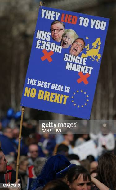 A demonstrator hold a placard as he prepares to participate in an anti Brexit proEuropean Union march in London on March 25 ahead of the British...