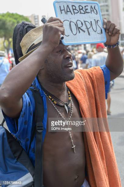 """Demonstrator holding a placard that reads """"habeas corpus"""", during the protest. Saturday 21 August 2021 is the sixth day of mobilization against the..."""