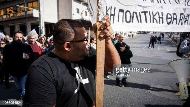 A demonstrator holds a banner as he takes part during a 24 hour strike in Athens Greece 28 November 2018Greece's largest private sector union GSEE...
