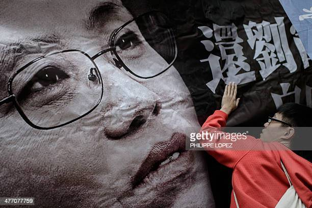 A demonstrator holds a banner before a march to the China Liaison office as they rally in support of Liu Xia the wife of imprisoned Chinese dissident...