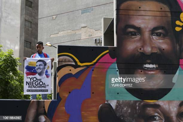 A demonstrator holds a banner during a protest promoted by relatives and parents to demand the freedom of political prisoners in Caracas Venezuela on...