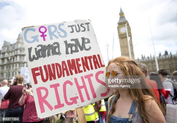 A demonstrator holds a banner reading ' Girls Just Wanna Have Fundamental Rights' during the Women's March Against The Democratic Unionist Party deal...