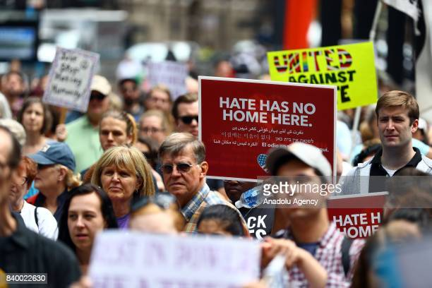 A demonstrator holds a banner reading Hate Has No Home Here during a protest against racism and hate in Chicago United States on August 27 2017...
