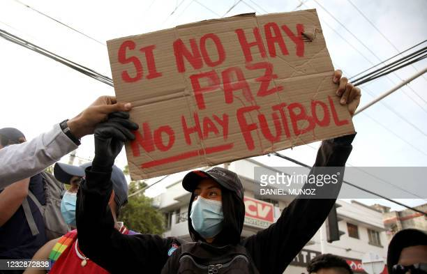 Demonstrator holds a banner reading 'No peace, no football' outside Romelio Martinez stadium in Barranquilla, Colombia, before the start of the Copa...