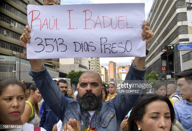 A demonstrator holds a banner reading 'Raul I Baduel 3513 days in jail' during a protest promoted by relatives and parents to demand the freedom of...