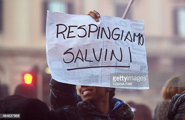 A demonstrator holds a banner that reads Reject Salvini in Piazza del Popolo in downtown Rome on February 27 during a demonstration to protest...