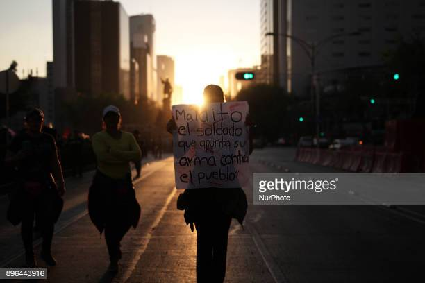 A demonstrator holds a banner while marching to protest against the Law of Internal Security a law that militarizes crime fighting in the country...
