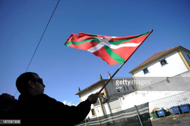 A demonstrator holds a Basque's flag during a march against the arrest of eight members of the Basque proindependence youth organization SEGI in the...