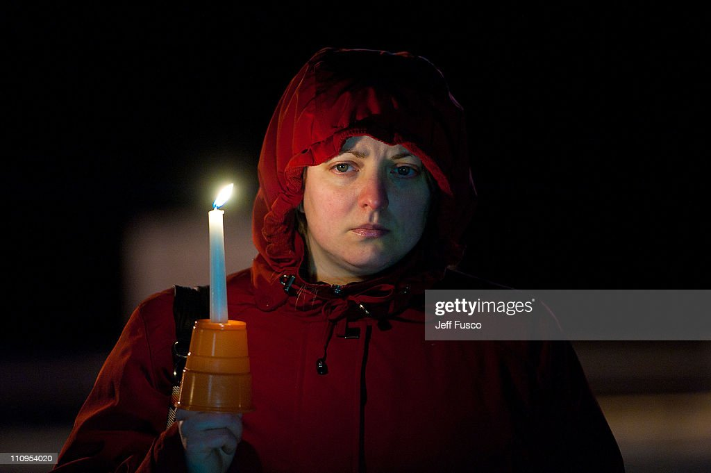 A demonstrator holds a candle at the 32nd annual vigil in remembrance of the disaster at the Three Mile Island Nuclear Plant March 28, 2011 in Middletown, Pennsylvania. The gathering to remember the accident, in which Unit #1's core melted down on March 28, 1979, is dedicated to the victims of the earthquake and tsunami in Japan.