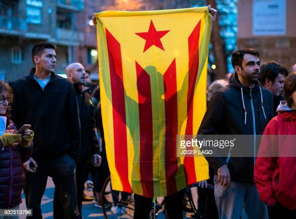 A demonstrator holds a Catalan proindependence 'Estelada' flag during a demonstration called by Omnium Cultural to demand a Catalan republic at Sant...