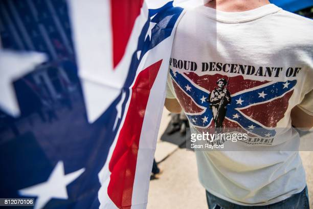A demonstrator holds a Confederate flag at the South Carolina Statehouse on July 10 2017 in Columbia South Carolina To mark the two year anniversary...