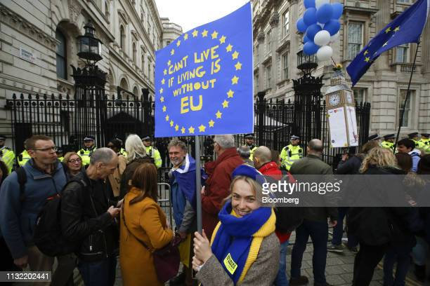 A demonstrator holds a European Union themed placard outside of the gates of Downing Street during the antiBrexit People's Vote rally in London UK on...
