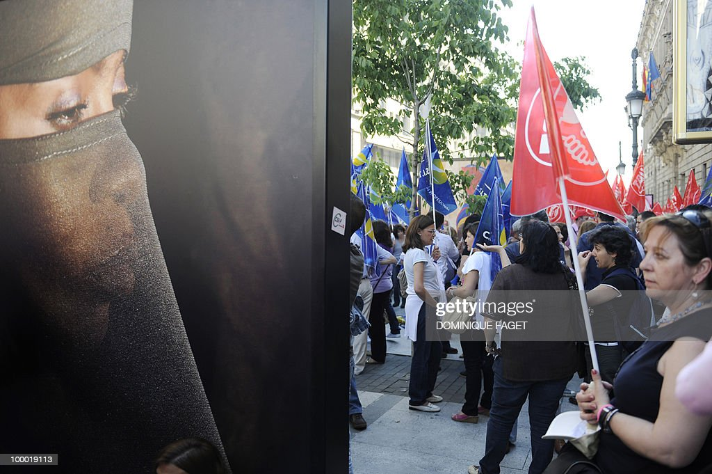 A demonstrator holds a flag during a demonstration of thousands of public servants against the austerity measures of the Spanish government in Madrid on May 20, 2010. Thousands of public sector workers took to the streets of Spain Thursday to protest a tough government austerity plan aimed at reining in the public deficit and easing fears of a Greek-style debt crisis.